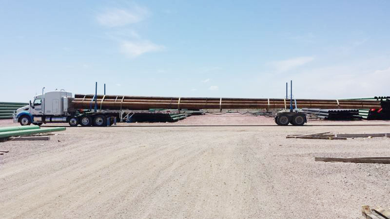 truck hauling wood logs at Adams Industries
