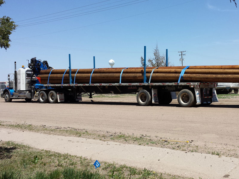 Adams Truck Trailer Hauling Wood Logs